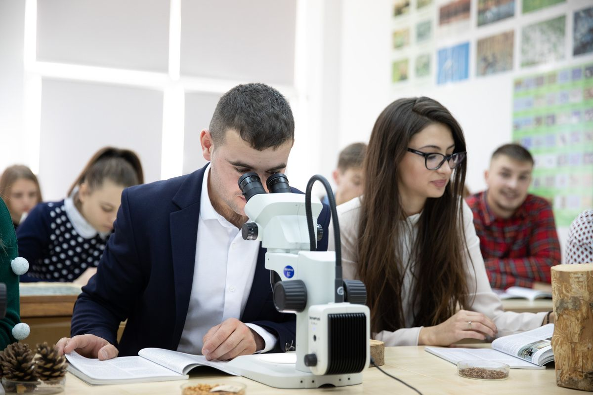 girl and bow students in science class