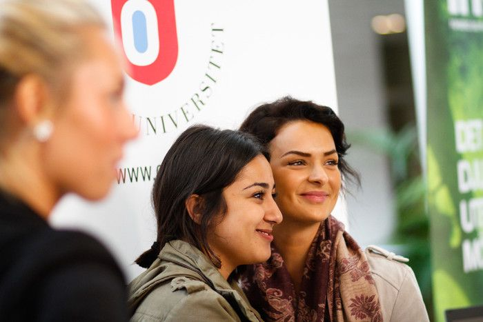 two girls smiling at a camera in orebro university