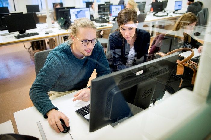 Two students regarding at a computer